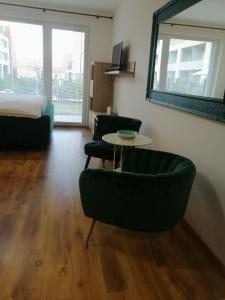 Posedenie v ubytovaní Entrez Apartments 5 - City center with small garden