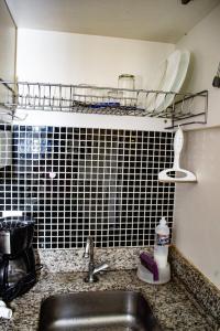 A bathroom at Kit Net - Vila Verde Sudoeste