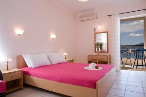 A bed or beds in a room at Aristea Apartments