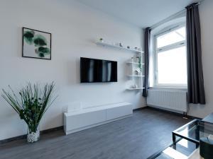 TV/Unterhaltungsangebot in der Unterkunft Moderne 3-Zimmerwohnung mitten im Stadtzentrum