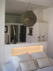 Cama o camas de una habitación en Apartamentos Casa del Coronel