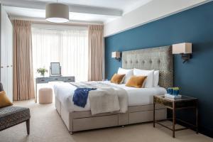 Un ou plusieurs lits dans un hébergement de l'établissement Arlington House Apartments