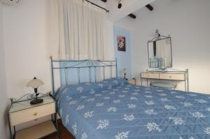 A bed or beds in a room at Vathi Hotel