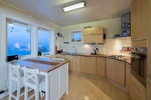 A kitchen or kitchenette at Nyken Resort - The House