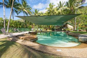 The swimming pool at or near Frangipani 103 - Hamilton Island