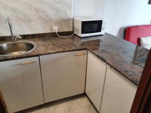 A kitchen or kitchenette at Apartamento centro Santander