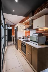 A kitchen or kitchenette at CAG The Vantage Rosebank