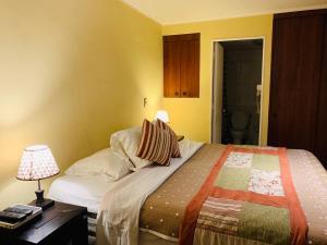 Cama o camas de una habitación en Infinity Apartments (Bellas Artes)