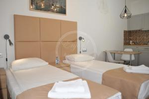 A bed or beds in a room at ENJOY! Apartments & Studios