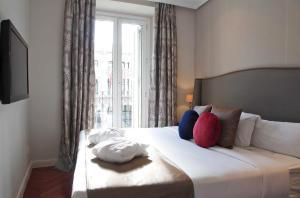 מיטה או מיטות בחדר ב-Luxury Suites