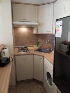 Una cocina o zona de cocina en Costanera Center Apartment