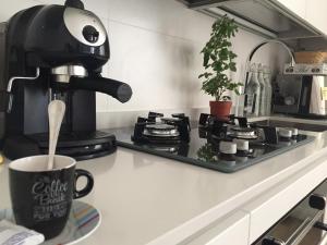 Coffee and tea-making facilities at Majestade apartment
