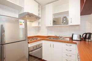 A kitchen or kitchenette at Bellavista Apartments