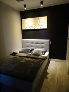 A bed or beds in a room at No71 The Luxury Apartment