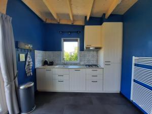 A kitchen or kitchenette at ZTLND Familylodge