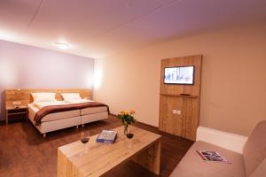 Ein Bett oder Betten in einem Zimmer der Unterkunft Wohntel - wohnen wie im Hotel
