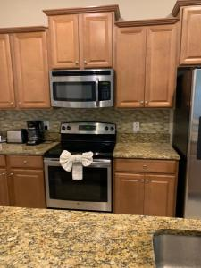A kitchen or kitchenette at DISNEY - 5 bedroom luxury vacation home - PARADISE PALMS RESORT