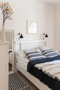 Łóżko lub łóżka w pokoju w obiekcie Apartamenty w Świnoujściu
