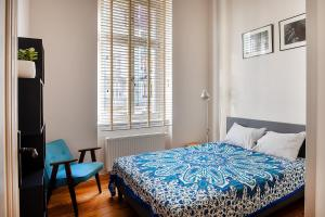 A bed or beds in a room at Movie Apartment Jeżyce