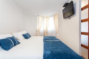 Cama o camas de una habitación en Infinity Apartments Departamentos Amoblados (Santiago Centro)
