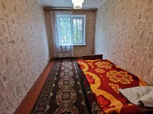 A bed or beds in a room at Ул Академика Павлова 11