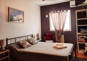 A bed or beds in a room at VILLA Can Salud