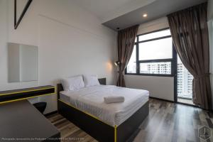 A bed or beds in a room at Arte S Penang
