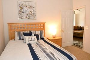 A bed or beds in a room at key2Indian Creek MODERN Pool Home FULLY RENOVATED