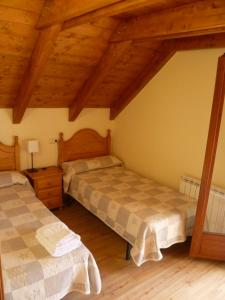 A bed or beds in a room at Casa Campolé