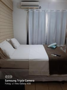 A bed or beds in a room at Flats Bueno em Goiânia