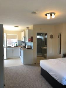 A kitchen or kitchenette at Brookacre Self Catering