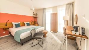 A bed or beds in a room at Dormio Resort Maastricht Apartments