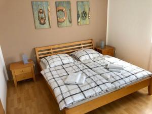 Postel nebo postele na pokoji v ubytování Apartmán Adam