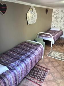 A bed or beds in a room at Letny Domik Holiday Home