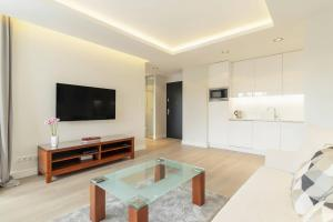 A television and/or entertainment centre at Grand Apartments