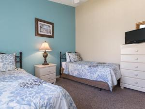 A bed or beds in a room at Indian Creek by Florida Star Vacations