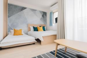 A bed or beds in a room at Juso AFP Luxury Apartment Hotel