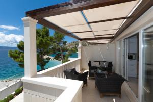 A balcony or terrace at Apartments Villa Carica