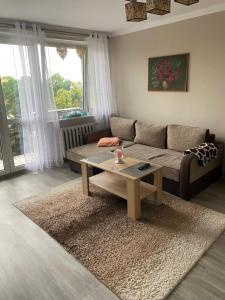 A seating area at Przytulne mieszkanie 2 pokojowe