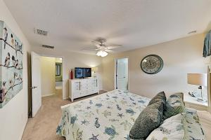 A bed or beds in a room at Ohana at Paradise Palms: Resort Townhome w/ Pool townhouse