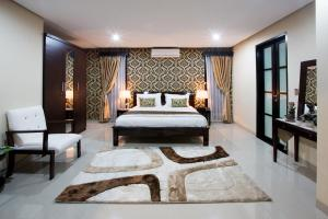 A bed or beds in a room at Cometa Villas Seminyak by Premier Hospitality Asia
