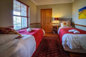 A bed or beds in a room at Berluda Farmhouse and Cottages