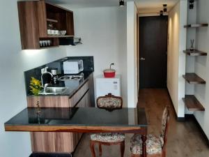 A kitchen or kitchenette at Apartach