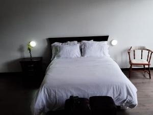 A bed or beds in a room at Apartach