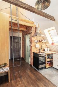 Kuchnia lub aneks kuchenny w obiekcie Apartament Gdański Gród