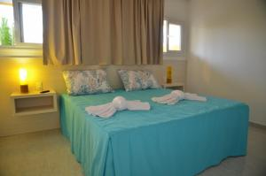 A bed or beds in a room at Oásis do Sol