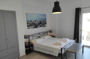 A bed or beds in a room at Milva Apartments