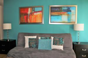 Cama o camas de una habitación en Puerta Alameda Suites