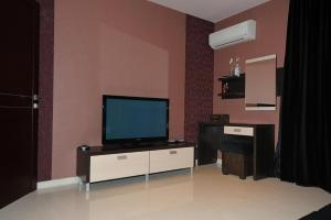 A television and/or entertainment center at Heaven Lux Apartments