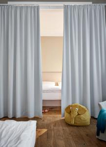 A bed or beds in a room at Wedina Apartments